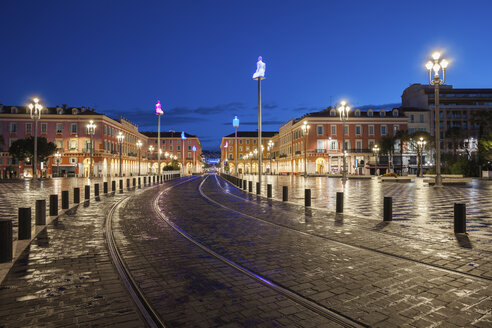 France, Provence-Alpes-Cote d'Azur, Nice, tramway on Place Massena at blue hour - ABOF00368