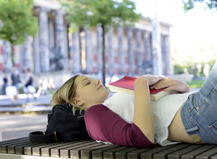 Young woman lying on bench - BFRF01841