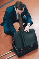 High angle view of businessman with suitcase at subway station - MASF07854