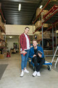 Portrait of smiling colleagues in distribution warehouse - MASF07962