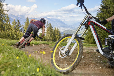 Austria, Tyrol, female downhill mountain biker - CVF00638