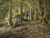 Austria, Tyrol, male and female downhill mountain biker - CVF00641