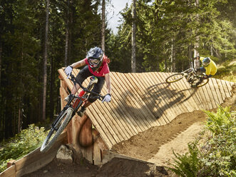 Austria, Tyrol, female and male downhill mountain biker - CVF00644