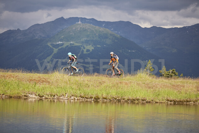 Austria, Tyrol, male and female mountainbiker - CVF00647