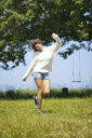 Young woman jumping around on meadow - MAEF12629