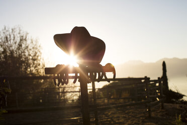 Cowboy hat in the sunset on a farm - ZEF15567