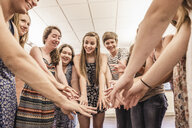 Circle of teenagers practicing dance in high school classroom - ISF07833