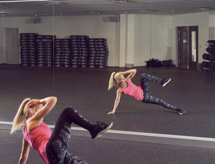 Woman stretching in gym - CUF21388