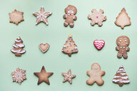 Rows of various gingerbread decorated with sugar icing on bright green ground - SKCF00461