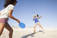 Women on beach playing tennis - CUF21467