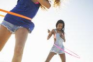 Women using hula hoop - CUF21476