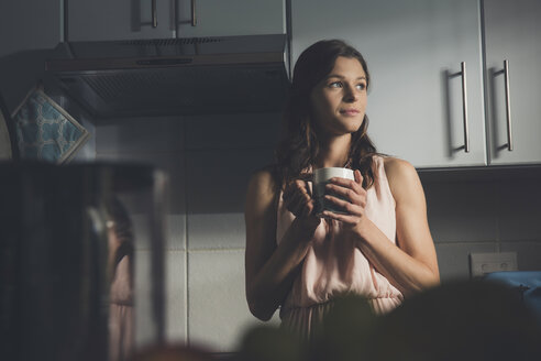 Young woman having a coffee break in kitchen - CUF21661