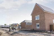 Apprentice builders digging on building site - CUF21835