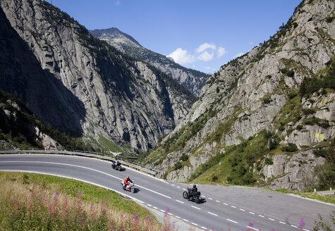 Bikers crossing Alpine, Gotthard Pass, Ticino, Switzerland - CUF22000