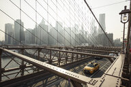 View of traffic and skyscrapers from Brooklyn Bridge, New York, USA - CUF22063