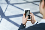 Close-up of businessman using cell phone - BSZF00508