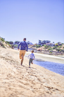 Australia, Adelaide, Onkaparinga River, father and son running on the beach - BEF00123