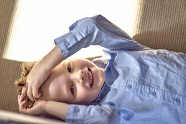 Portrait of happy boy lying on couch - BEF00145