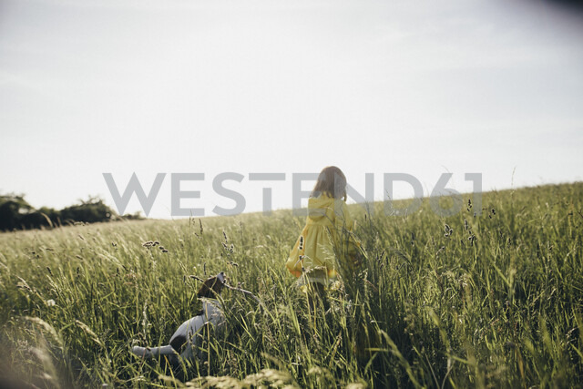 Little girl and dog in nature - KMKF00258