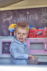 Portrait of boy playing in playhouse - BEF00159