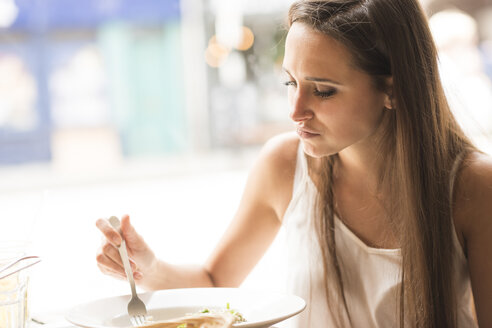 Young woman eating lunch in restaurant - CUF22276
