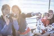 Young tourist woman and girl with binoculars on boat trip, Cape Town, South Africa - ISF08117