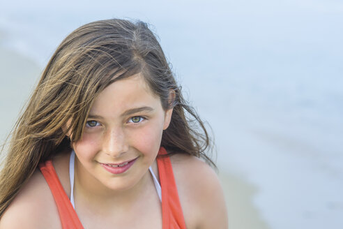 Portrait of teenage girl on beach, Asbury Park, New Jersey, USA - ISF08421