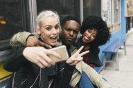 Friends in street taking selfie - ISF08508