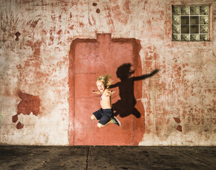 Boy jumping in mid air - ISF08559