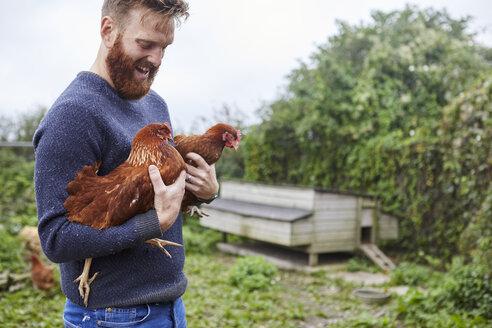 Man holding chickens - CUF22716