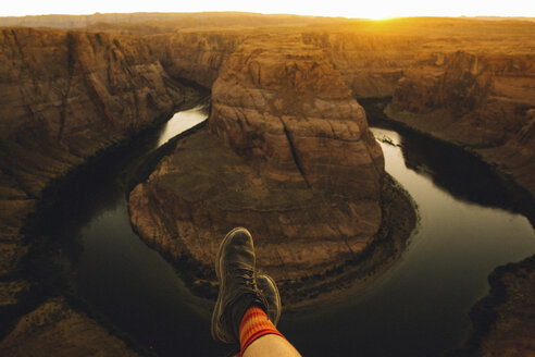 Person relaxing and enjoying view, Horseshoe Bend, Page, Arizona, USA - ISF08778