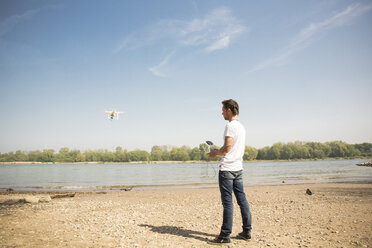 Man flying drone at a river - ONF01139