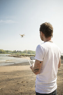 Man flying drone at a river - ONF01142