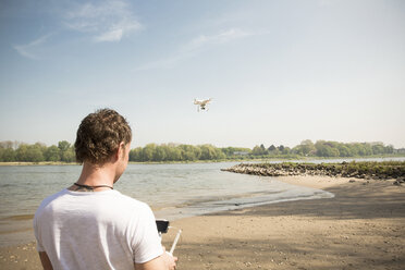 Man flying drone at a river - ONF01145