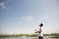 Man flying drone at a river - ONF01148