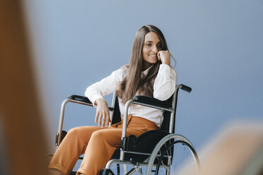 Young handicapped woman sitting in wheelchair, smiling - KNSF03906