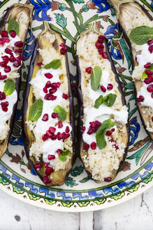 Filled aubergines with couscous, yogurt sauce, mint and pomegranate seeds - LVF07016