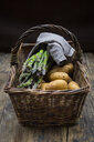 Organic green asparagus and organic potatoes in wickerbasket - LVF07025
