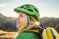 Cyclist enjoying view of mountain biking area, Kleinwalsertal, trails below Walser Hammerspitze, Austria - CUF22855