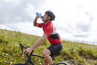 Cyclist stopping to drink - CUF22882