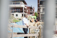 Man on construction site looking around - MOEF01302