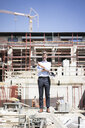 Portrait of happy man standing on construction site - MOEF01314