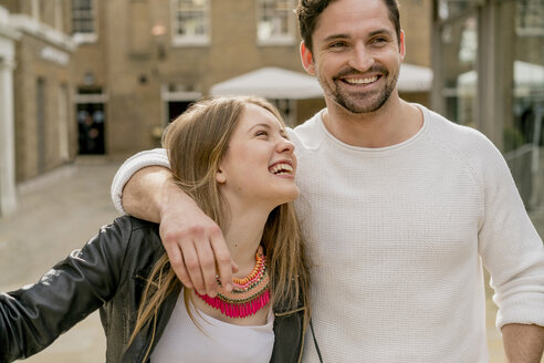 Happy young couple on Kings Road, London, UK - CUF23070
