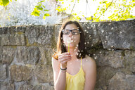 Portrait of girl blowing blowball - LVF07031