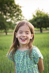 Portrait of happy little girl in nature - LVF07034