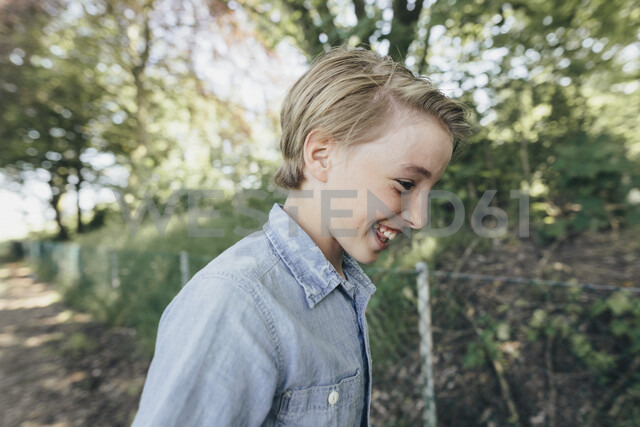 Laughing boy on forest path - KMKF00326