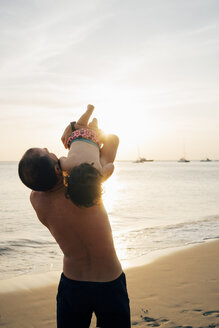 Thailand, Koh Lanta, father playing with his little daughter on the beach at sunset - GEMF02057