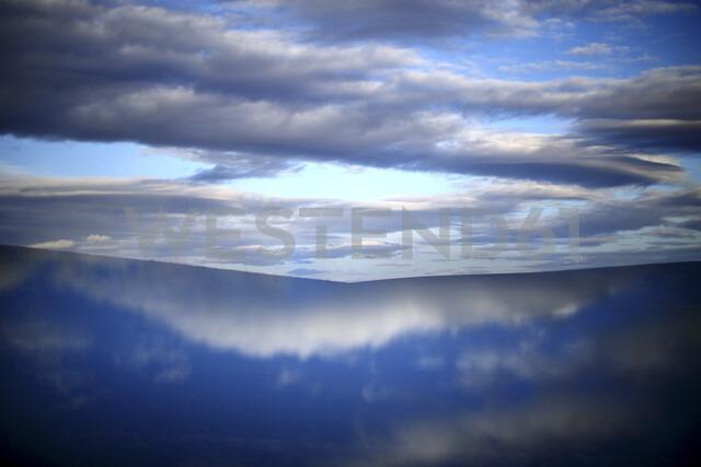Spain, Castilla y Leon, Province of Zamora, Reserva natural de Lagunas de Villafafila, water reflection and clouds - DSGF01747