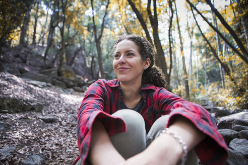 Young female hiker sitting in forest, Arcadia, California, USA - ISF08808