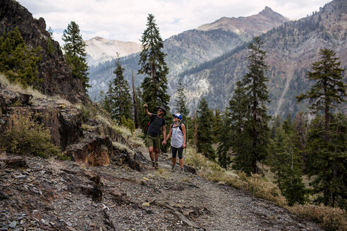 Mid adult couple hiking along pathway, Mineral King, Sequoia National Park, California, USA - ISF08817